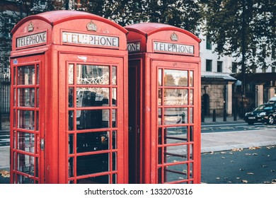 Two typical London red telephone cabins
