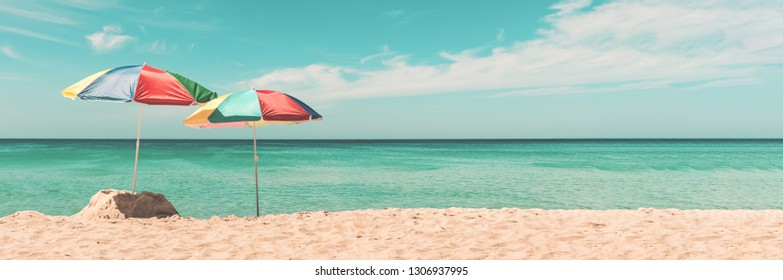Two umbrella on the tropical beach. Summer Holiday Banner,Pastel colors tone