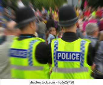 Two uniform police overseeing crowd of spectators