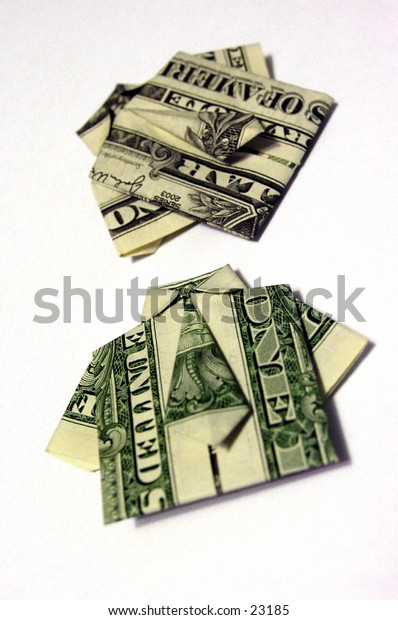Two United States dollar bills folded origami style into a shirt and tie