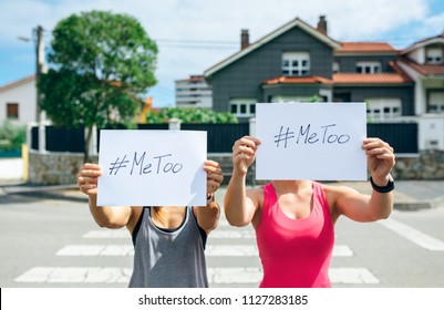 Two unrecognizable young women showing poster with metoo hashtag