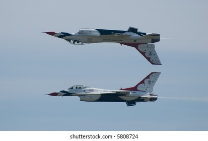 Two US Air Force Thunderbirds, one flying inverted