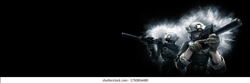 Two US marine corps soldiers with weapons going to attack. Shot in studio. Explosion on black background. (panoramic image, poster design)