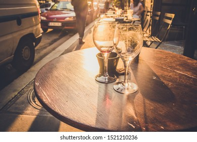 Two used wine glasses in the sunset