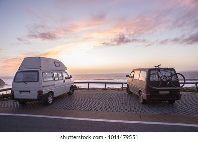 Two vans parking by the ocean in beautiful sunset scene