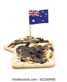 Two Vegemite crackers with an Australian Flag isolated against white.