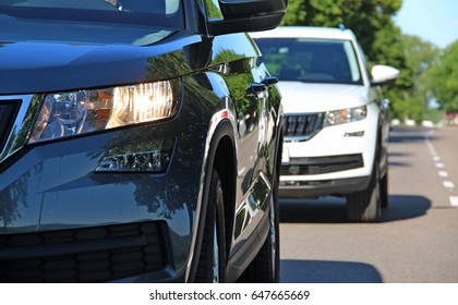Two vehicles in motion at the suburban road stock photo