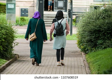 Two Veiled Muslim woman walking in the street near the train station
