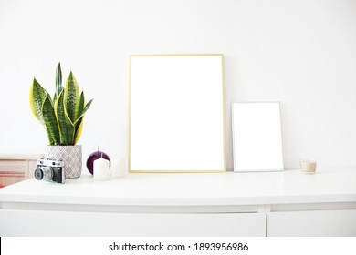 two vertical empty frames on the table