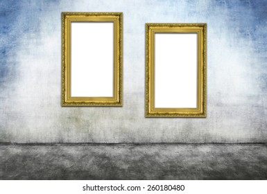 Two vertical golden frames on gray dirty wall