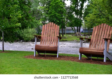 Two very large park chairs along the Fox River in Waterford Wisconsin.