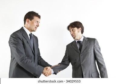two  victorious businessmen shacking hands