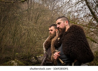two Viking warriors in the forest