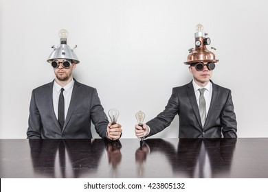 Two vintage businessman sitting at office desk