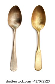Two vintage dinner spoons at white background