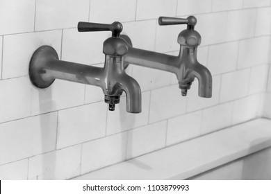 Two vintage faucets