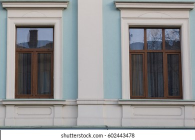 Two vintage front glass windows of an old house
