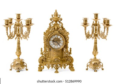 Two vintage gold candle holder and clock on a white background