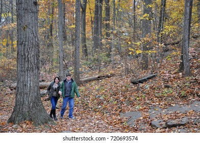 Two visitors walking in the Forest in Autumn on the Trail to Big Round Top, with Colorful Autumn Leaves, Gettysburg National Battlefield Park - October 31, 2016