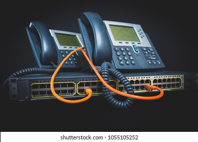 Two VOIP Phones and Switch