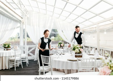 Two waiters serve at the restaurant