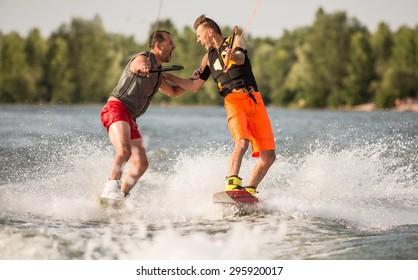 Two wake bord riders are having fun