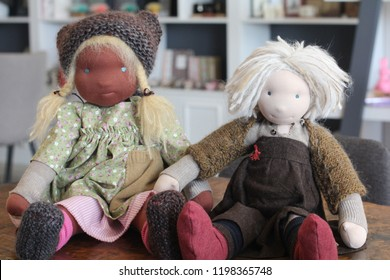 Two waldorf dolls sitting