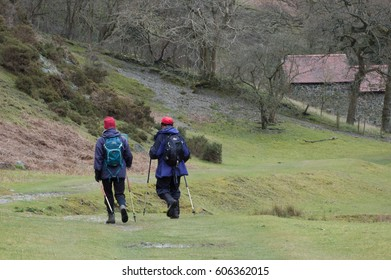 Two walkers, hiking through the trail in Cardingmill Valley the Long Mynd Shropshire