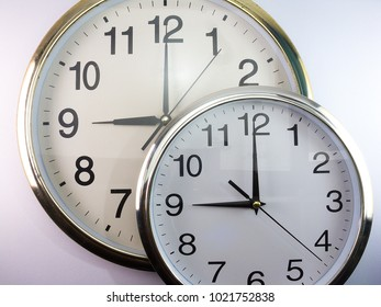 Two wall clocks on a white background.