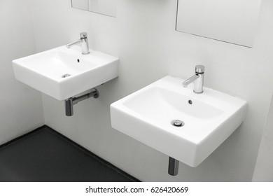 Two washbasin to European public toilet, Two modern ceramic washbasins, Ceramic sink with chrome mixer in contemporary washroom, Modern european washbasin, Modern minimalist washstand