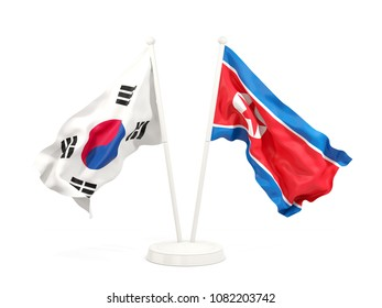 Two waving flags of North Korea and South Korea isolated on white. 3D illustration