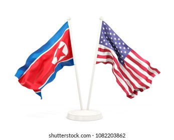 Two waving flags of North Korea and USA isolated on white. 3D illustration