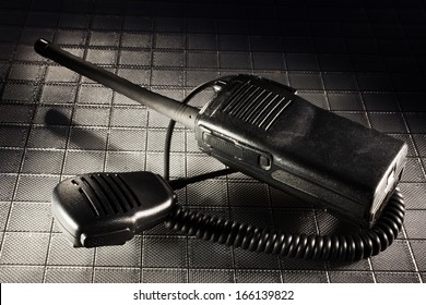 Two way radio in the dark along with its microphone