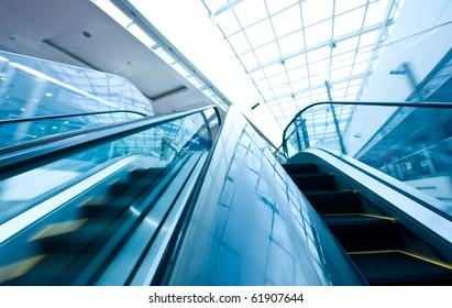 Two ways escalator in blue tone.  ( motion blur)