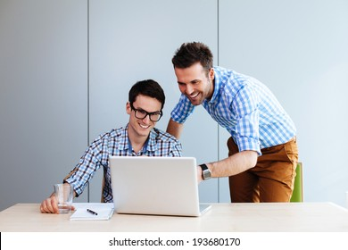 Two web designers looking at a website they designed