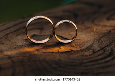 Two wedding engagement rings on a wooden base For a gold ring of a loving wedding couple.Concept of love.