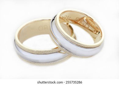 Two wedding golden rings isolated on white