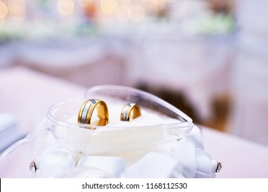 Two wedding rings in the glass heart