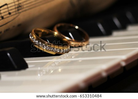 Two Wedding Rings On Piano Old Stock Photo Edit Now 653310484