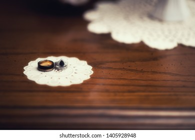 Two wedding rings on a table