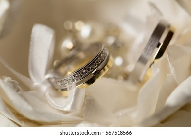 two wedding rings in a white box