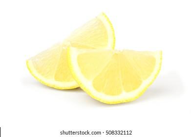 Two wedges of fresh lemon isolated on white background cutout.