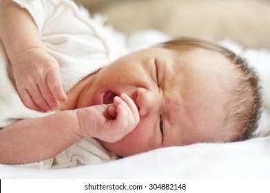 Two weeks old baby lying on the bed