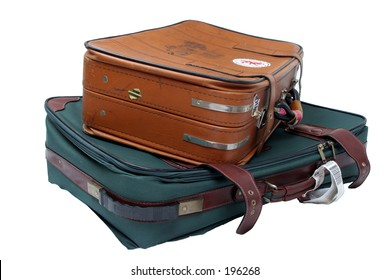 Two well used suitcases all packed and ready to go on vacation!