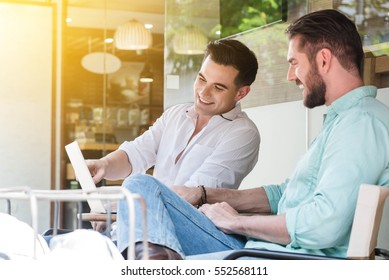 Two Westerner Business men working with laptop and smartphone together
