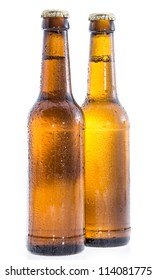 Two wet bottles of Beer isolated on white background