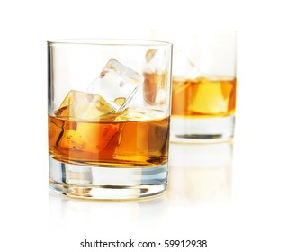 Two whiskey glasses. Isolated on white with reflection