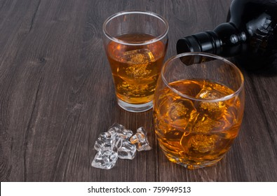 two whisky on the rock on wood and wood background