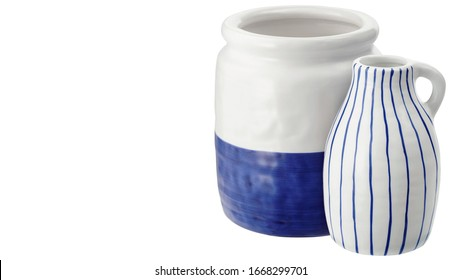 Two white ceramic vases with blue patterns isolated on white background