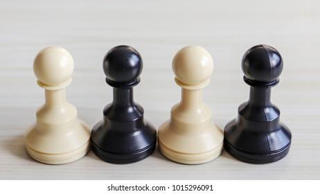 Two white chessman and two black chessman.